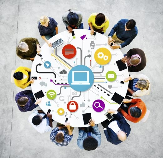 People at a round table with networking graphic. iStock Rawpixel Ltd